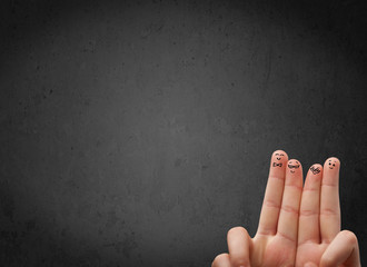 Happy finger smileys with empty copy space dark background
