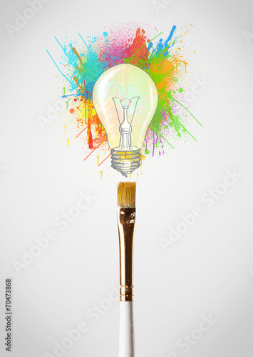 canvas print picture Brush close-up with colored paint splashes and lightbulb
