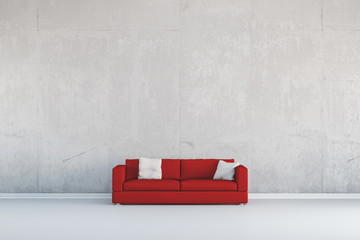 Rotes Sofa vor Wand aus Beton