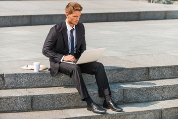 Businessman working outdoors.