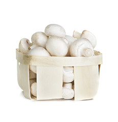 Champignon mushrooms in a wooden container
