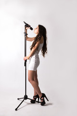 Young artist holding a microphone.