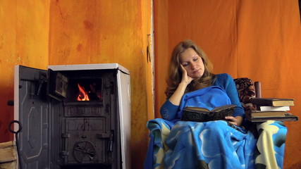 Tired student woman girl fall asleep studying near rural stove