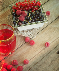 juice of fresh fruit and berries on a wooden table