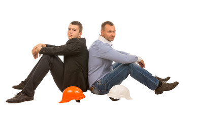 Two Men with Hard Hats Sitting Back to Back