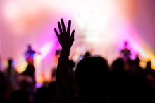 "Постер, картина, фотообои ""christian music concert with raised hand"""