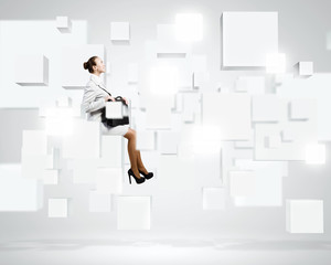 Woman on cube