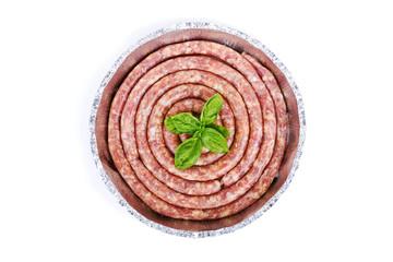 Fresh raw LUGANEGA sausage in aluminum dish isolated on white ba