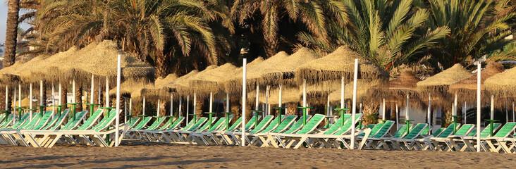 Beach lounge chair and beach umbrella. Costa del Sol, Spain