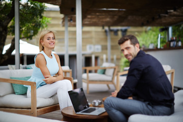 Young businessman discussing plan with colleague at work break