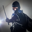 Special forces policeman/soldier with tactical police baton