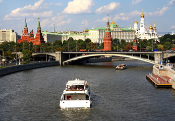 Moscow, Russia . Boat goes along  on  background of the Kremlin
