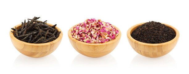 Assortment of tea in a wooden bowl. Kuding, rose, black tea