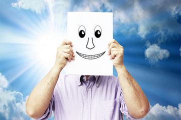 Man with a smile drawn in a white sheet