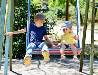 brother and sister on the swing