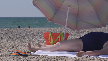 Overweight person at the summer beach