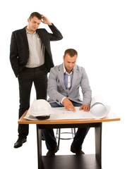 Two architects or builders working on a plan