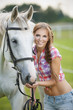 Beautiful smiling woman with gray horse