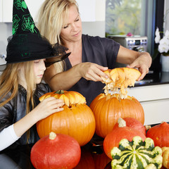Mother prepares pumpkins in the kitchen