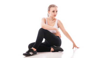Beautiful sporty woman doing exercise isolated