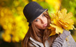 Beautiful autumn woman in golden park