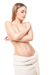 Woman after bath with towel isolated on white