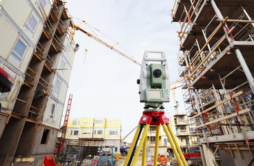 surveying instrument inside large building site, industry