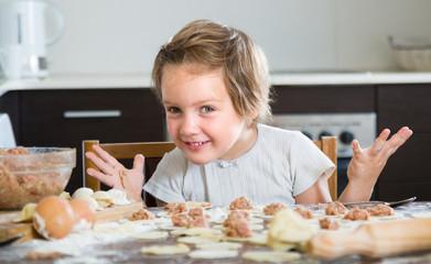 Child cooking meat dumplings