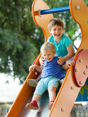 happy children on slide