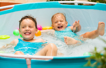 Children swimming in kid pool