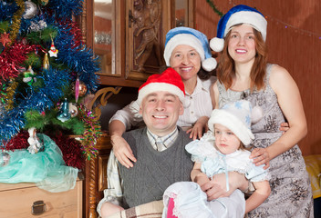 Portrait of happy family in christmas hats