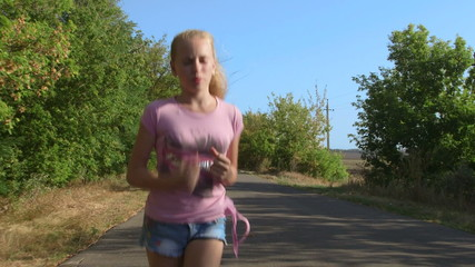 girl running along country road