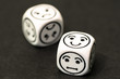 dice with happy emoticon side