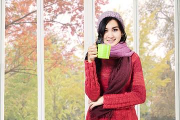 Asian woman drinking hot cappuccino