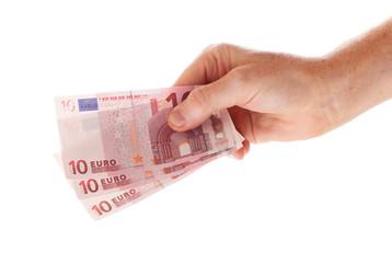 Hand holding three 10 euro bills