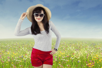 Attractive young woman on the meadow