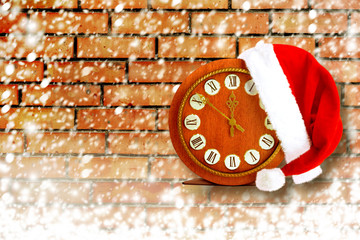 Santa Claus hat on New Year's night on the old clock showing twe