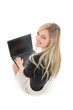 canvas print picture - Woman with Laptop Smiling Over Shoulder at Camera