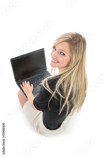 canvas print picture Woman with Laptop Smiling Over Shoulder at Camera