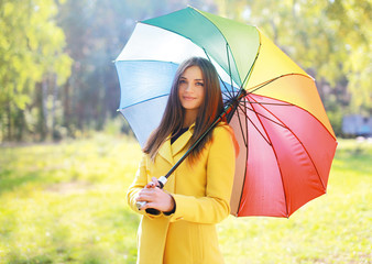 Beautiful woman with colorful umbrella, pretty girl posing in au