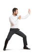 man standing in pose as karate