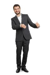smiley businessman holding something