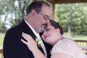 Bride Lays Head on Grooms Shoulder