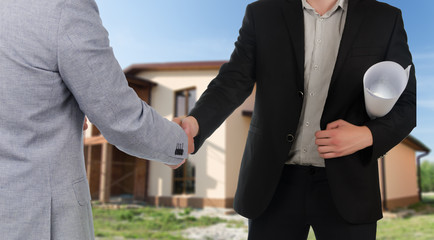 Builder or architect congratulating a client