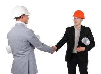 Architect and engineer or builder shaking hands