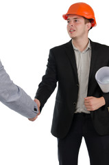 Young architect shaking hands with a businessman