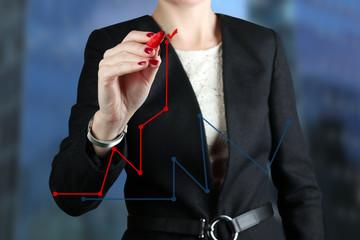 Businesswoman  drawing a virtual  graph