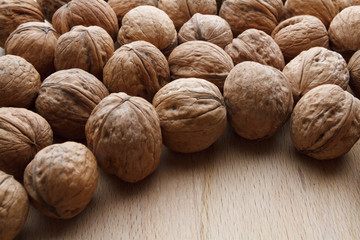 Walnut on wooden background