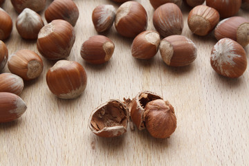 Hazelnut on wooden background