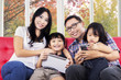 Happy family with digital tablet at home